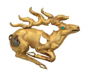 A gold stag inlaid with turquoise