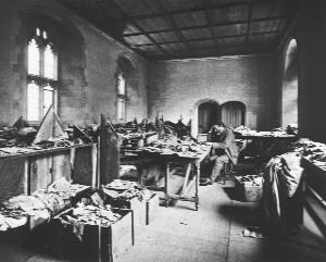 Cambridge lecturer Solomon Schechter among thousands of Genizah fragments in his office after their transportation from the Ben Ezra synagogue in Cairo.